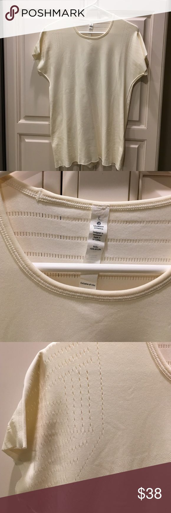 Lululemon cream short sleeve top Size large, 100% rayon. There is the Lululemon emblem in the print of the top in the front with laser cut detailing on the shoulders and back. Shoulder to shoulder is 16 inches, length sleeve is 6 inches, armpit to armpit is 18 1/2 inches in length is 27 inches. lululemon athletica Tops Tees - Short Sleeve
