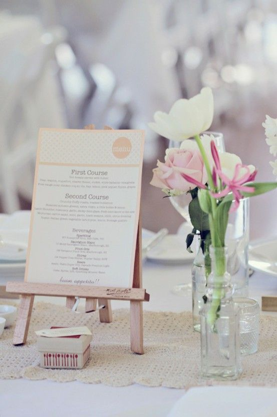 These tiny art easels are perfect for making your menu part of table's centerpiece. Photo by Poppy Lane via Style Me Pretty.