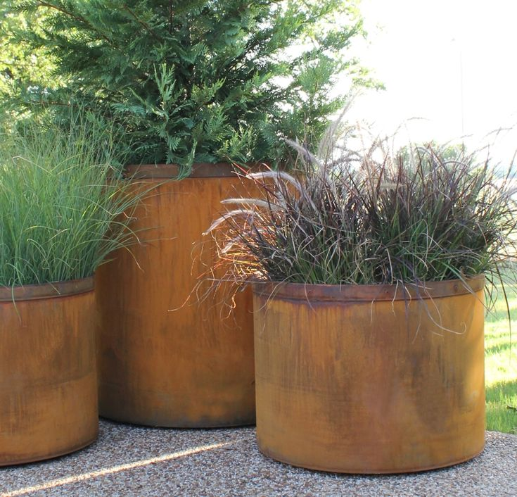 Again, use of planters for veges/herbs/fruit trees. I like the rust look but wonder if there is rust run off problems or leaching issues?