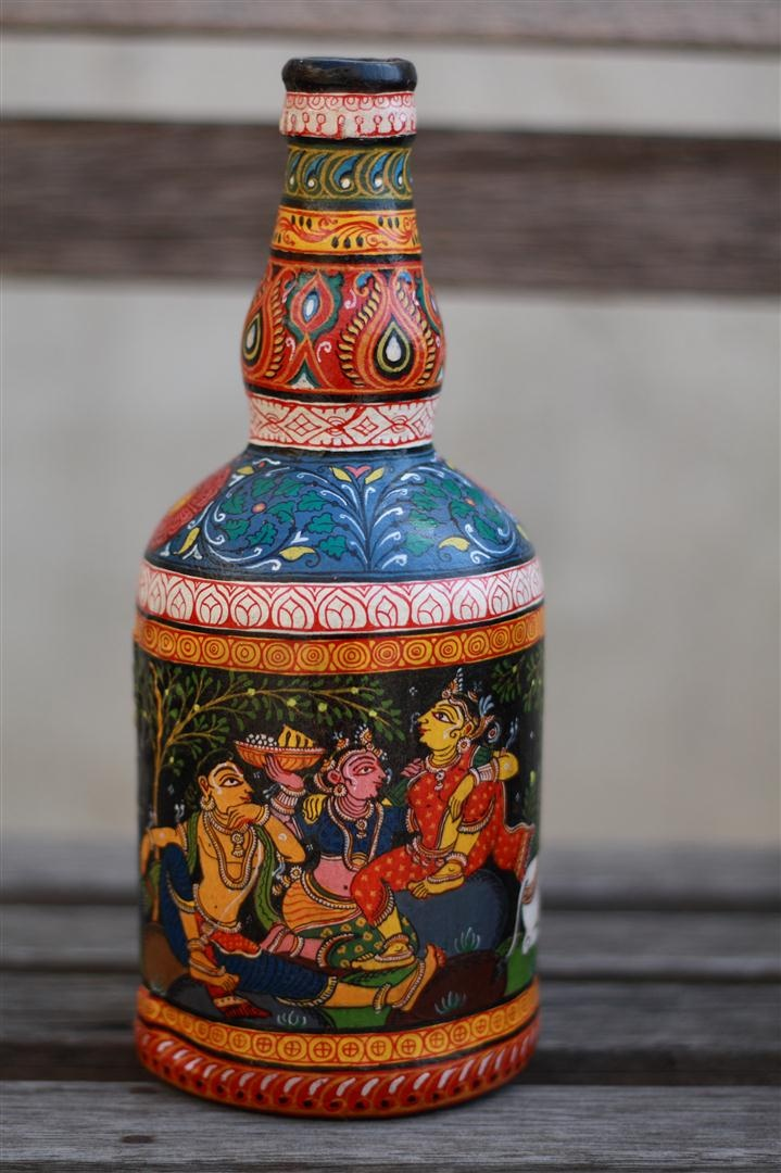 The Color Caravan works with some of the 'finest' pattachitra artists from Orissa, India. This bottle has been co-created by our partner artists and The Color Caravan. It takes about 3 days to just prepare the canvas and another 7-8 days to paint & finally lacquer coat one bottle.Traditionally, stories from the Ramayana,Krishna Lila, incarnations of Lord Vishnu and Lord Jagannath are painted.This beautiful & unique piece of art makes an eye-catching showpiece. source: www.thecolorcaravan.com
