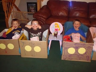 """Drive-in movie night for kids. Each decorates their own car/box & an envelope of play money to buy snacks at the """"concession stand""""."""
