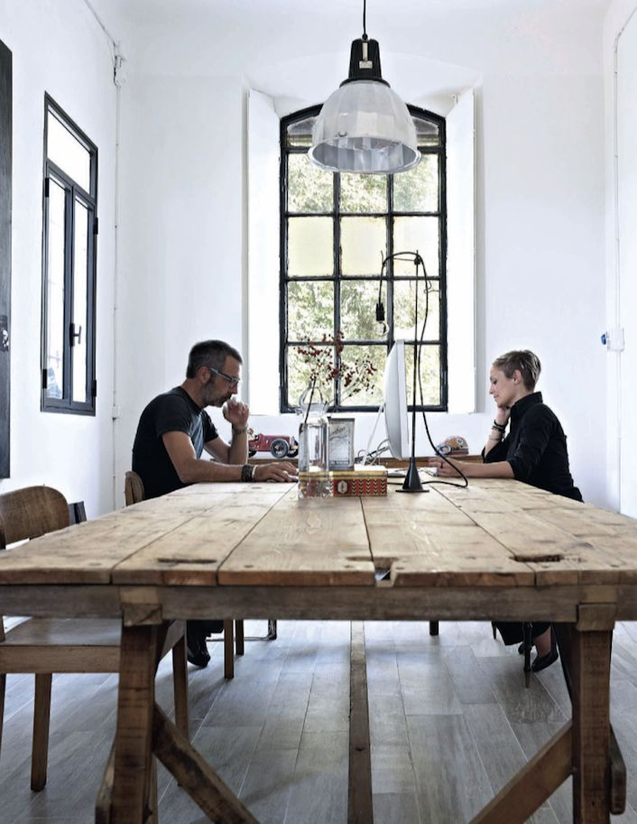 Art director Giovanni Mazza and stylist Francesca Dalla Costa from design company Secondalinea in their studio within a former school in Reggio Emilia, Italy. Photo Fabrizio Cicconi/Living Inside, featured Elle Decoration UK January 2013.
