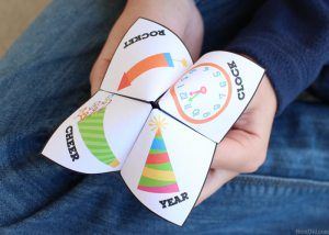 """Make New Year's Eve a fun family celebration! This free printable New Year's Eve party game is great for both kids and adults. The paper fortune teller will """"magically"""" predict the answers your most burning questions for the next year as you select pictures and numbers."""