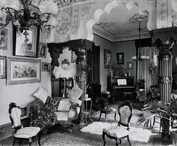 Typical interior during American Victorian period. Clutter, over-accessorized, multiple patterns, obscure traffic patterns.