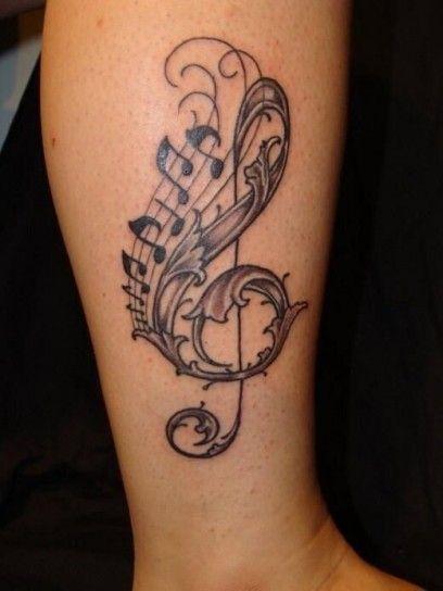 Tatuaggio chiave di violino e note in stile tribale
