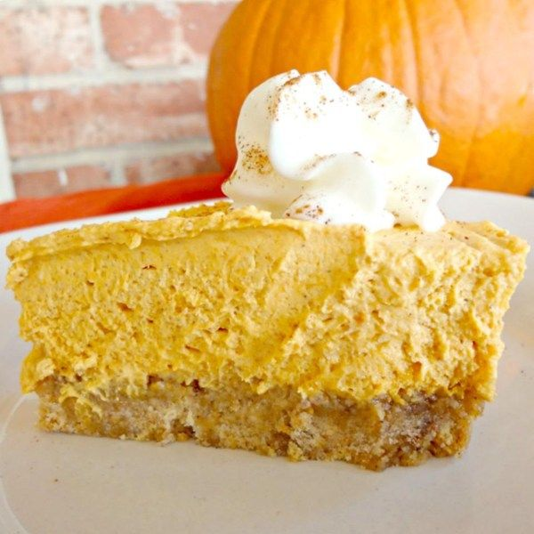 "Whipped Pumpkin Pie | ""This is a wonderful light whipped pumpkin pie. My husband doesn't like traditional pumpkin pie but loves this recipe I came up with. The cream cheese adds a wonderful flavor with a traditional pie taste but light/whipped. It is made with a homemade graham cracker crust."""