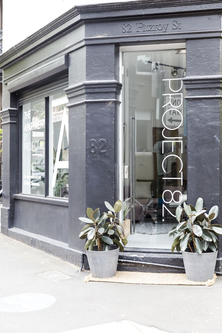 Our beautiful storefront, with our branding sitting happily on a sleek glass door.