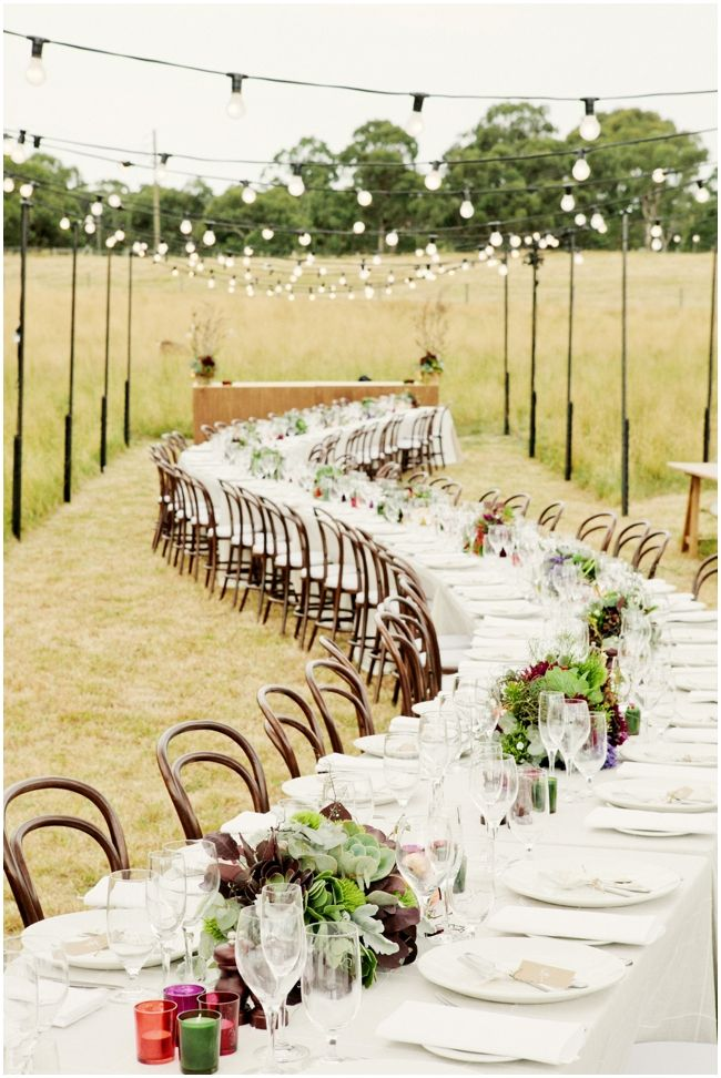 Long and lanky table literally carved into a field for the guests.  Love it!  check out more great ideas @louisabaileyweddings.com