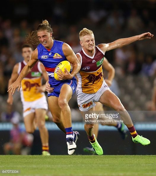 Roarke Smith of the Bulldogs and Nick Robertson of the Lions in action during the AFL 2017 JLT Community Series match between the Western Bulldogs...