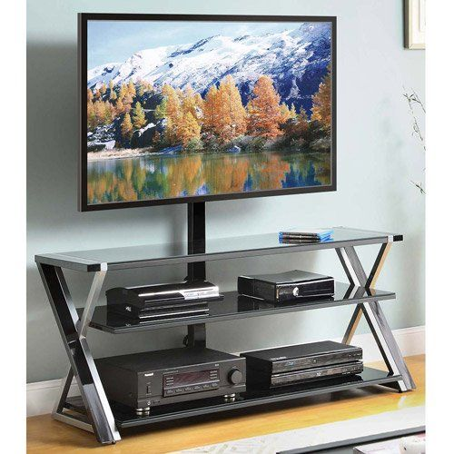 "Set your entertainment center up properly with the Whalen 3-In-1 Black TV Console for TVs up to 70"". This TV console table is perfect for flat-screen TVs and offers convenient storage for media components, games, DVDs, and more. It has the patented versatility for use as a tabletop, universal wall mount or as a swinging floater. Wall mounting hardware is included. The TV stand is suitable for TVs up to 60 inches on tabletop and up to 70 inches on the mount and has a weight capacity of 1..."