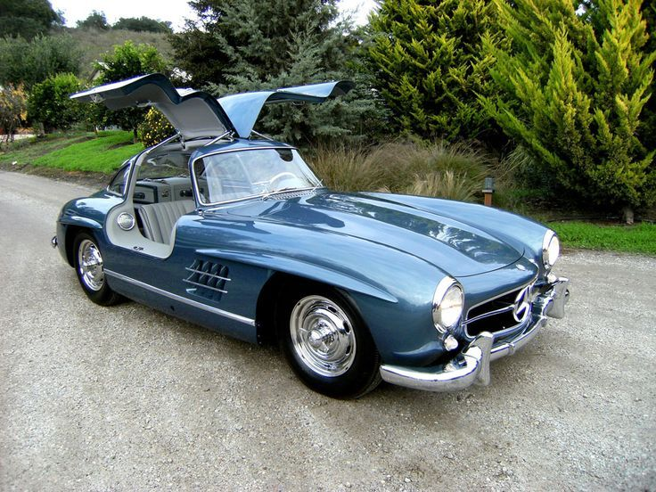 The 1955 Mercedesbenz 300 Sl S Flip Up Doors Hinged At The Roof Center In Order To Lift Upward Were Revoluti Mercedes Benz 300 Bmw Classic Cars Classic Cars