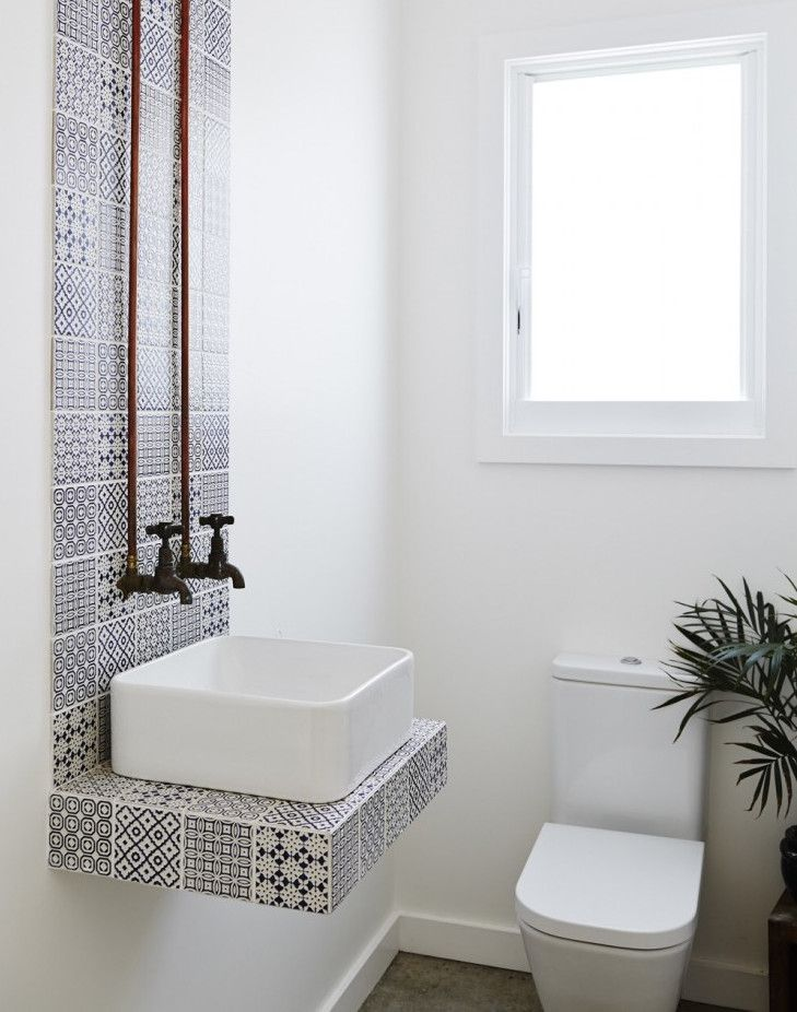 square vessel sink - In a small Hawaiian powder room, chintz print indigo and white tile makes a pristine shelf for the vessel sink - Remodelista via Atticmag