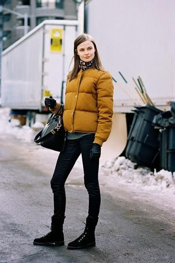 20 outfits that show puffer coats CAN be stylish - mustard yellow puffer coat with black combat boots