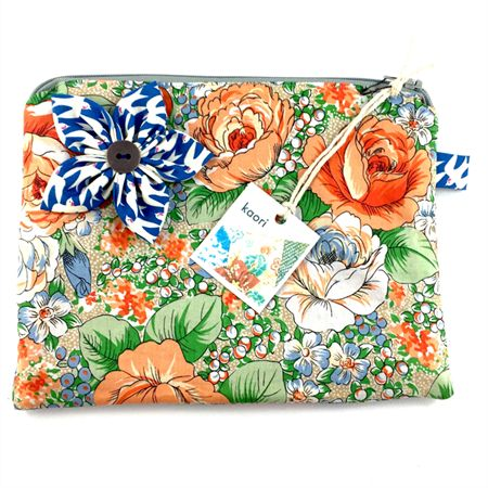 Cosmetics case / wash bag with detachable flower brooch - Peach and green floral
