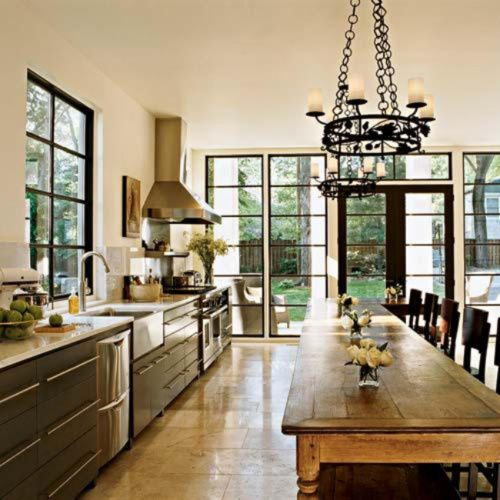 Large kitchen table instead of an island with bench that fits under one side. Think I'd rather do this - huge kitchen with huge table - than a separate, formal dining room. Everyone ends up in the kitchen anyway. More fun.