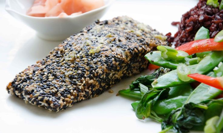 Sesame crusted salmon with ginger garlic dressing. A refreshing ginger dressing compliments this Asian Style Salmon! Perfect as we transition into spring! Easy to make, full of omegas, and of course, gluten free!
