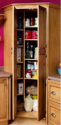 A full-height pantry cabinet reclaims an otherwise underutilized corner of  the kitchen. Photo