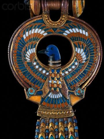 Egypt | Cloisonne earring from tomb of Tutankhamun's | The central feauture is described as a falcon with a duck's head its wings creating a sweeping circle around its head and its talons clutching shen rings, beneath the tail feathers is a bar decorated with circles from which hang five strings of gold and glass beads ending in pendant uraei. | Located in: Egyptian Museum, Cairo. | © Sandro Vannini