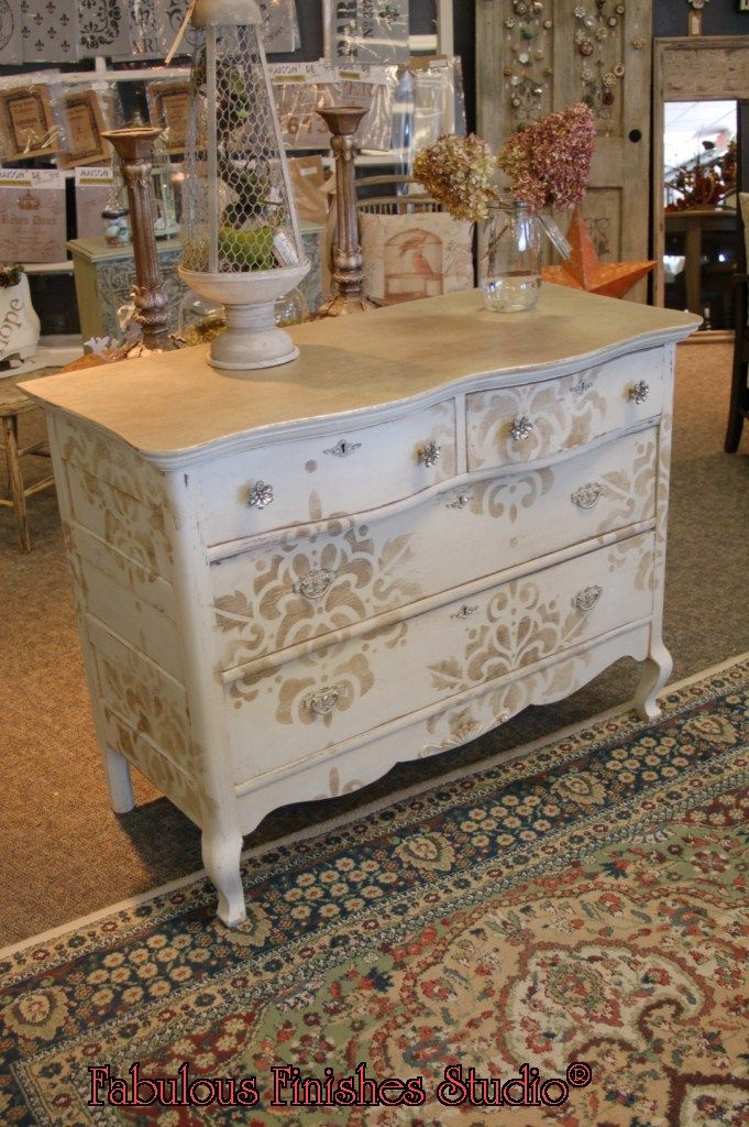 Gorgeous stencilling and knobs on this dresser!