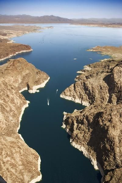 Lake Mead. (24) Past Grand Canyon is Black Canyon, most of which is flooded by Lake Mead created by Hoover Dam. Here the Virgin River also joins thevColorado.
