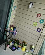 Cute little patio makeover with recycled jars