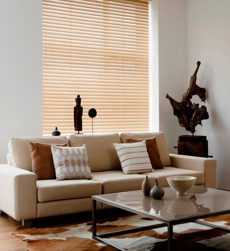 this light coloured venetian blind complements this neutral living room interior