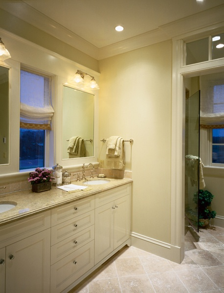 window between vanity mirror and transom window  Bathroom