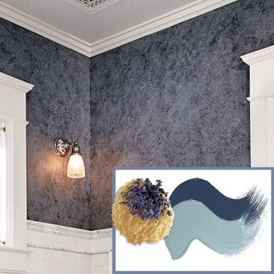 a sea sponge daubed with dark blue paint and 2 hues of paint daubs against a Victorian-style bathroom