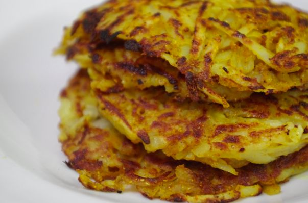 Potato rosti by Karen Martini. 4 Potatoes ( waxy) par boil slightly. Set aside & cool. Grate & season with salt, pepper. Sprinkle in flour, mix carefully with fingers. Tennis ball size put on BBQ, squash down a little with hand. Use spatula to flatten further, cook for about 3 minutes each side. Use olive oil on BBQ & may need to add more during cooking to crisp up rosti's. Serve with bacon & eggs