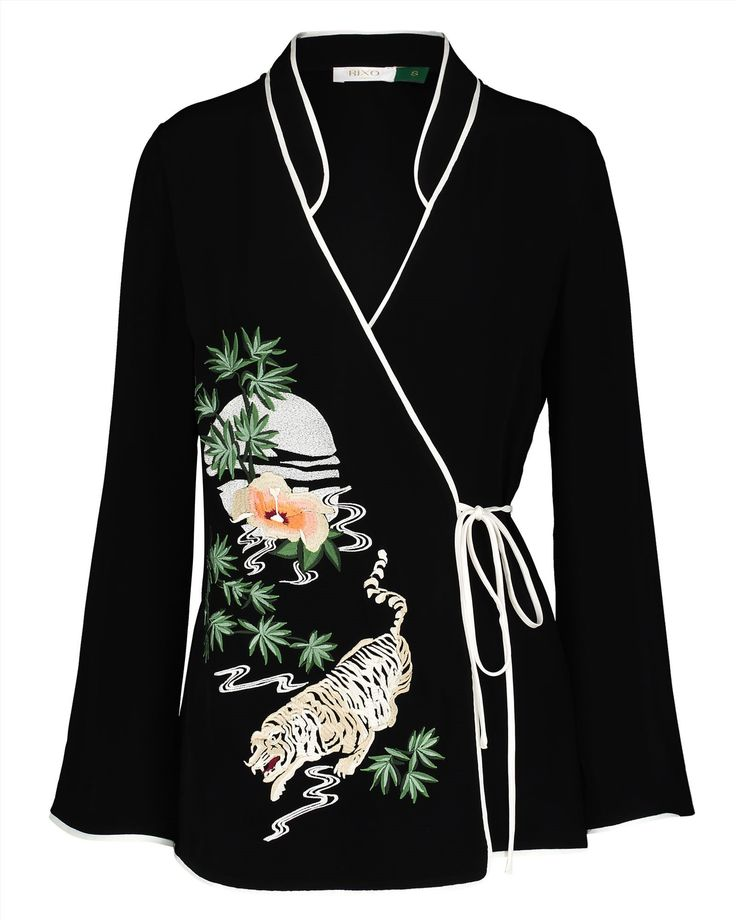 Wrap V top. Tiger oriental themed embroidery on the front. Slight bell sleeve arms. 100%viscose. Hand wash.