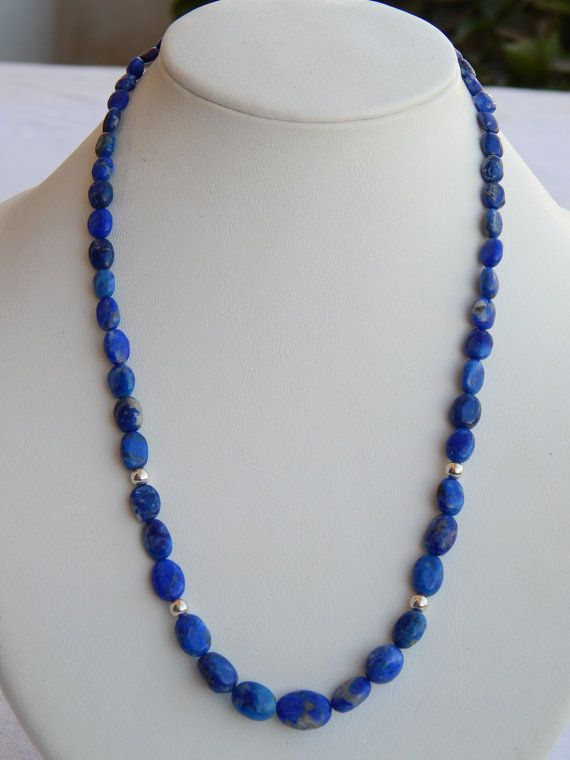 Check out this item in my Etsy shop https://www.etsy.com/uk/listing/487164290/100-natural-lapis-lazuli-smooth-oval