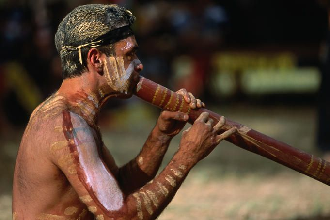 Performer playing the didgeridoo for the Mona Mona Mayi Wunba Aboriginal Dancers at the Laura Festival.
