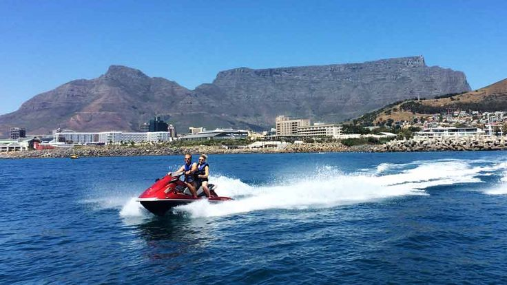 Jet ski with Table Mountain in the backdrop. Book at https://exploresideways.com/