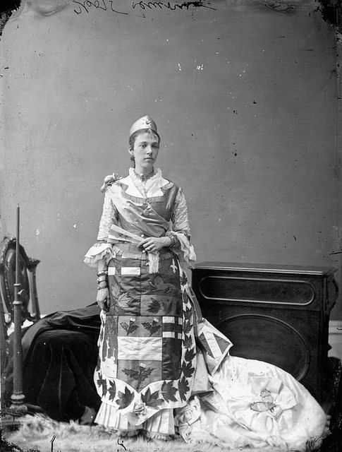 A young Victorian woman sporting a costume featuring symbols of the British Empire. #Victorian #vintage #Canada #history #women