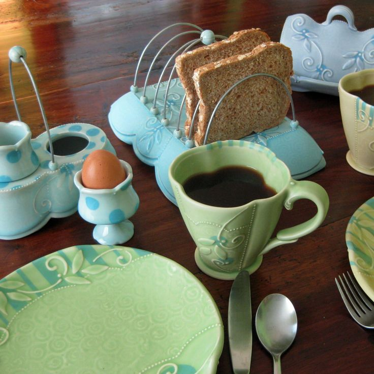 Handmade pots for Breakfast by Kristen Kieffer, including toast rack, removable egg cups and serving tray, and butter dish.