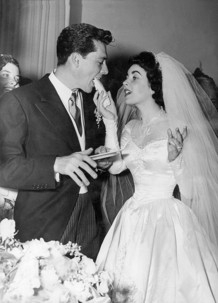 Elizabeth Taylor's Wedding #1 May 6, 1950 (she was 18 years old) hes gorgeous and i love her dress!