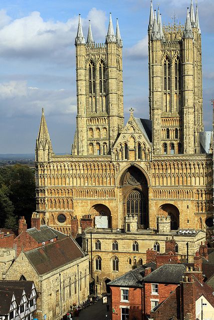 Lincoln, England; English Renaissance style.  Here you can see a cathedral built of stone.  On the top two levels you can see cresting along the top edges.  The arch in the center looks like a gothic-tudor arch.