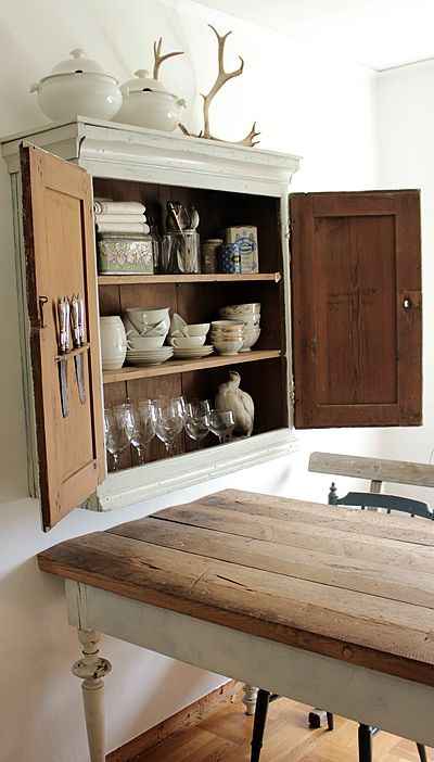 Charming idea: install a wall cabinet directly over the breakfast nook or kitchen table for easy access to everyday dishware
