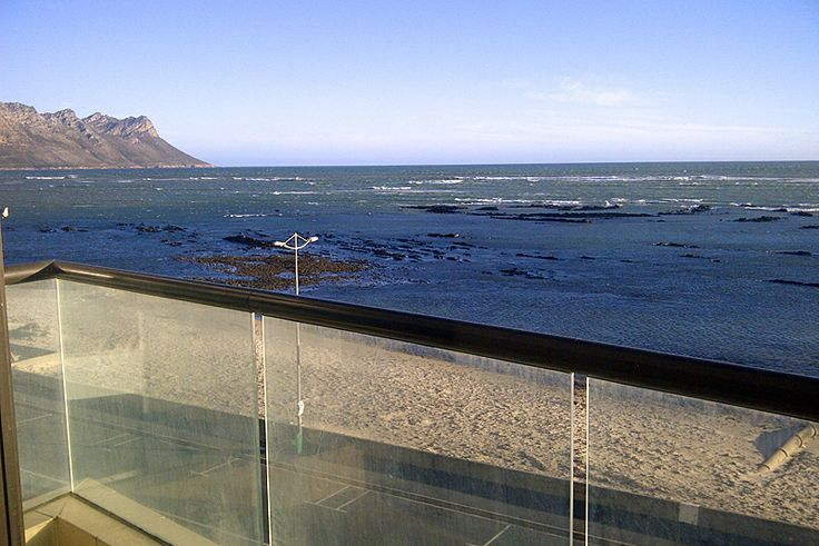 Ocean View 202A - A Self Catering Apartment in Strand, Cape Metro & Cape Town. This modern self-catering apartment:  is on the front row of the golden sandy, main swimming beach of Strand; is on the 4rth floor and offers magnificent views of the Cape Peninsula as far as Table Mountain and even Cape Point