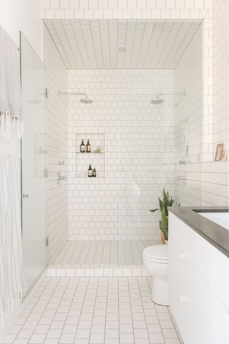 All-white, floor-to-ceiling subway tile perfection.