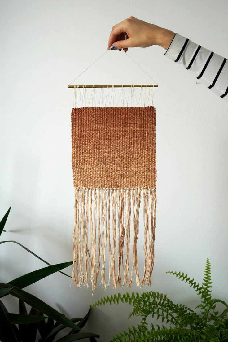 This delicate wall hanging from the series Plant Dyed is an unique decoration made of 100% natural materials.   It's woven with special, handspun and naturally dyed woolen high quality yarns.  Oranges and pinks come from avocado dyeing.  Over time those yarns can change it's collor a little