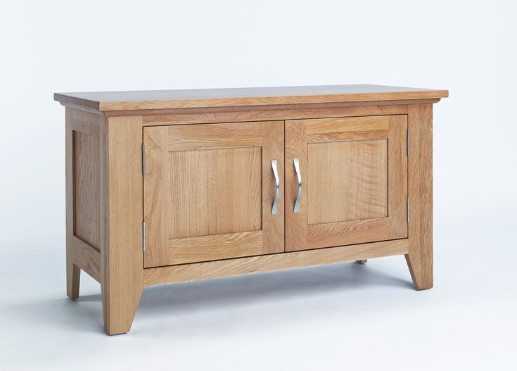 The Sherwood Oak Cabinet 2 Door is part of The Sherwood Oak range is made of a high quality grade of oak and exhibits all the hallmarks of quality furniture.These include wood-panelled drawer bases and cabinet backs and the use of dovetailed joints in constructing drawers.Sherwood Oak furniture features a decorative curved beading to the underside of cabinet tops and chamfered, rather than square finished leg ends to all floor-standing cabinets.Sherwood Oak furniture has a light oak…