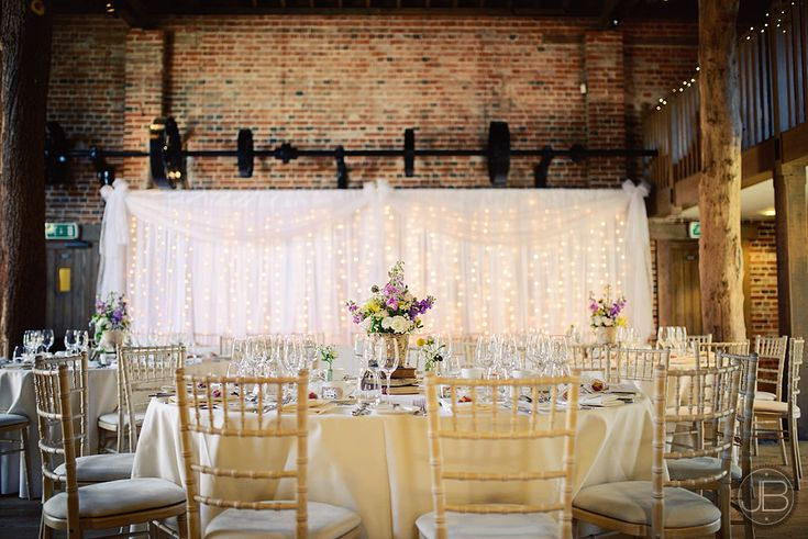 Twinkly backdrop by Mediterranean Occasions in the Mill Barn at www.gaynespark.co.uk Wedding_Photography_Gaynes_Park_by Justin_Bailey Photography _LM_July_2013_007