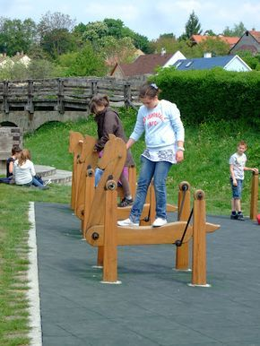 Wooden rocking horses for the playground.