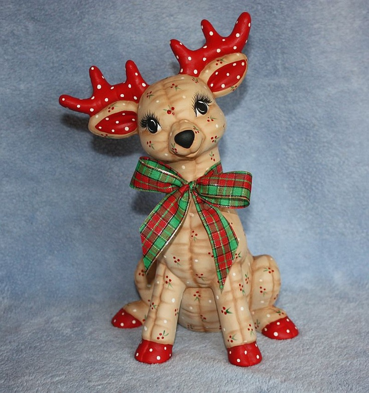 awww. looks like one from Rudolph movie......Handpainted Ceramic Christmas Reindeer painted with a Holly Berry print to look stuffed and a plaid ribbon. $26.95, via Etsy.