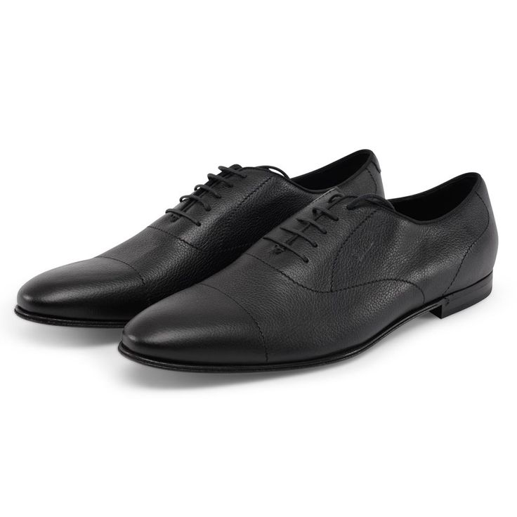 A pair of Gucci Black Leather Lace-up Shoes. Made from soft grained leather with a small Gucci insignia stamped on one side. New, unworn condition.