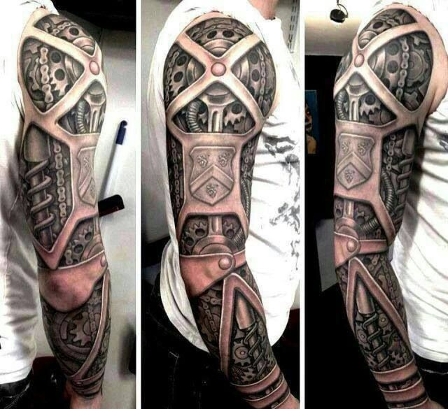 Tattoo by Rob Richardson at Immortal Art Custom Tattoo Studio in Carlisle, Cumbria, CA (Jeff has this as a cover for his cybernetic arm with his family crest in place of the shield)