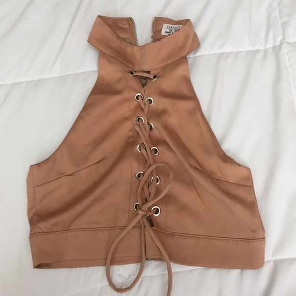 White fox boutique crop top Camel colored. Lace up front with zip up back. Crop top. Worn only once. Size small, from Australia so it's says size 8, but that's 4 in the US. Whitefox boutique  Tops Crop Tops
