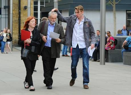 Jeremy Corbyn's son Sebastian pats his father's head before a rally in King's Cross station in London (PA)