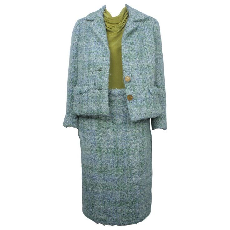 Fully lined classic 1960s mohair suit in a blue and green nubby weave. Description from 1stdibs.com. I searched for this on bing.com/images